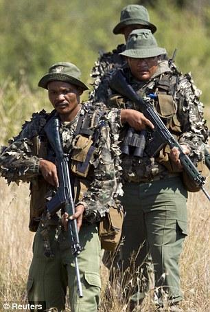 Members of the Anti-Poaching Unit (APU) patrol in Pilanesberg National Park on April 19, 2012