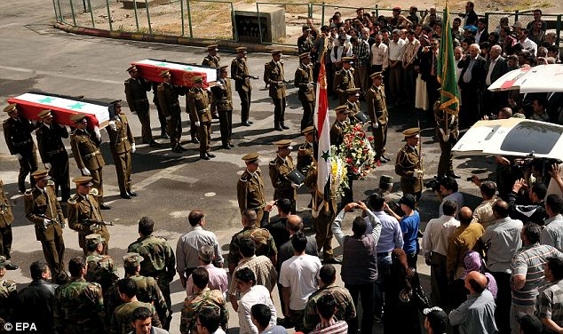 A funeral procession of Syrian policemen in Damascus on Thursday