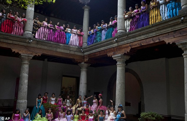 Party: Fifteen-year-old girls pose for a group picture at the Franz Mayer museum before a mass