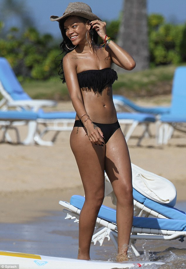 You da one: Rihanna showed off her incredibly toned figure in a black two piece on Friday in Hawaii