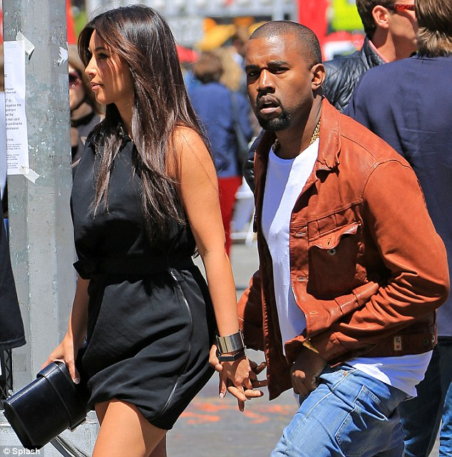 Together again: Kim Kardashian was back with Kanye West today as they held hands on a lunch date to Serafina in NYC