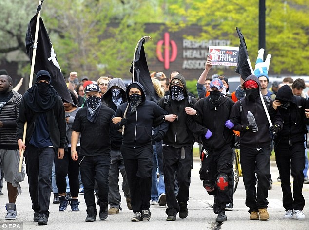 Intimidating: Occupy protestors join immigrant and workers' rights protesters in Chicago, lllinois