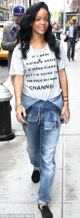 Bare-faced cheek: Rihanna went make-up free when she stepped out in New York today