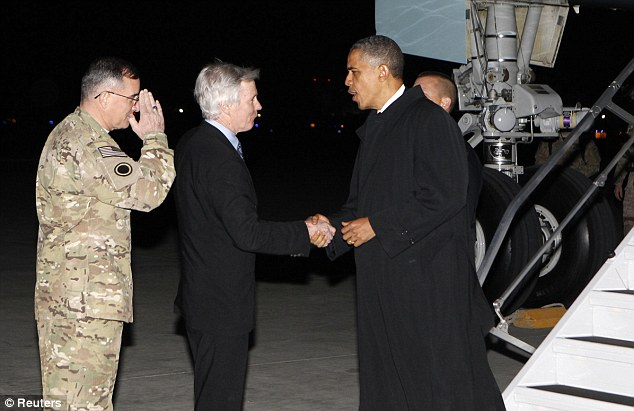 Unannounced visit: President Obama shakes hands with U.S. Ambassador to Afghanistan Ryan Crocker after arriving at Bagram Air Base in Kabul, Afghanistan