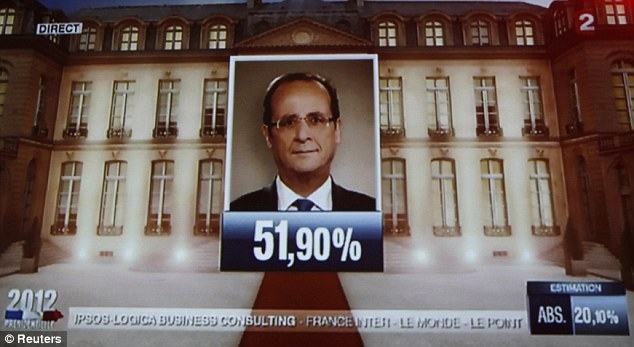 Victorious: The face of the newly-elected French President appears on a giant screen at the local Socialist party headquarters in Strasbourg