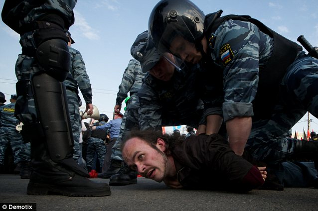 'Riots': More than 400 people were arrested as there were reports people were dragged by the hair and neck