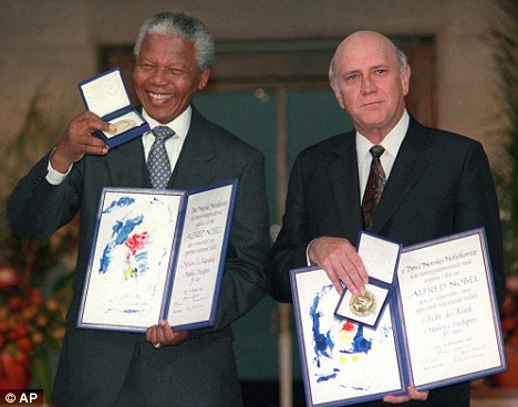 Former South African presidents Nelson Mandela, left, and FW de Klerk, right, pose with their Nobel Peace Prizes in Oslo in 1993