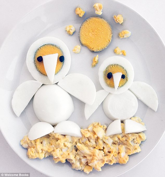 Hoot: A mother owl and her baby have been crafted out of boiled eggs as a sun made of yolk shines down on them