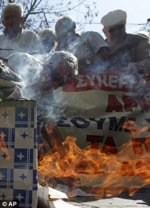 Civil unrest: Pensioners burn emergency tax notices during an anti austerity protest