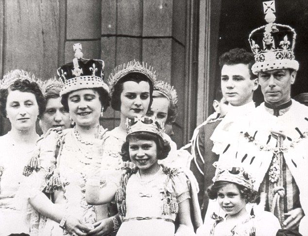 Crowds: King George VI and Queen Elizabeth on coronation day on 12 May 1937 when Princesses Elizabeth and Margaret came out onto the Palace balcony to receive the acclaim of the crowds
