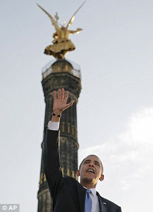 In this July 24, 2008 file photo, President-elect Barack Obama, bottom center, shakes hands with his supporters after speaking at the Victory Column in Berlin