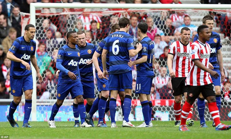 Delight: United celebrate Wayne Rooney's crucial goal at Sunderland - before City's big collapse