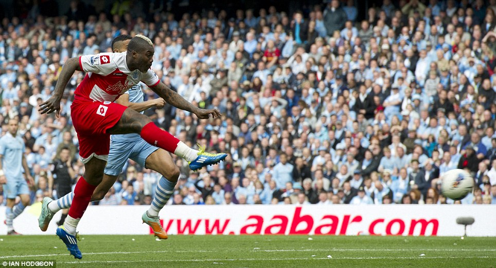 Shock to the system: Djibril Cisse equalises for QPR to stun the home crowd at 1-1