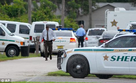 Scene: Sheriff's deputies in Brevard County investigating after 33-year-old Tanya Thomas shot her four children and then herself