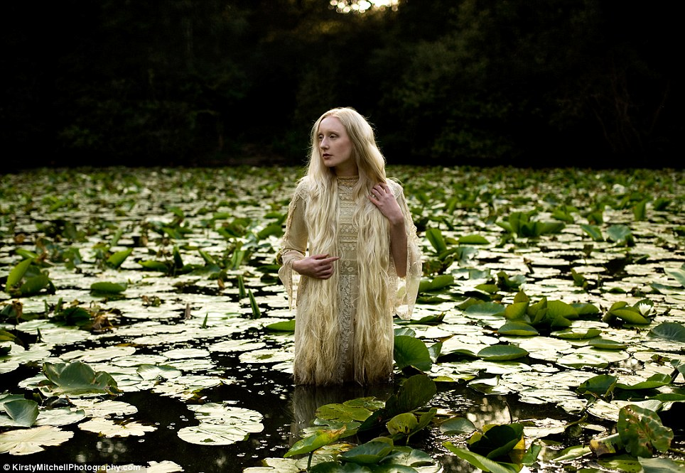 Lady of The Lake: a model emerges from a pool of lilies amidst the forest