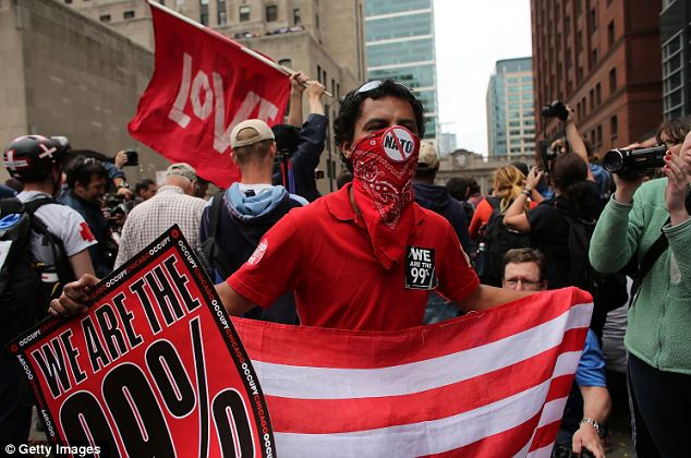Unrest: Hundreds of protesters, many affiliated with the Occupy Wall Street movement, demonstrate in front of the Boeing headquarters on the second day of the NATO summit yesterday