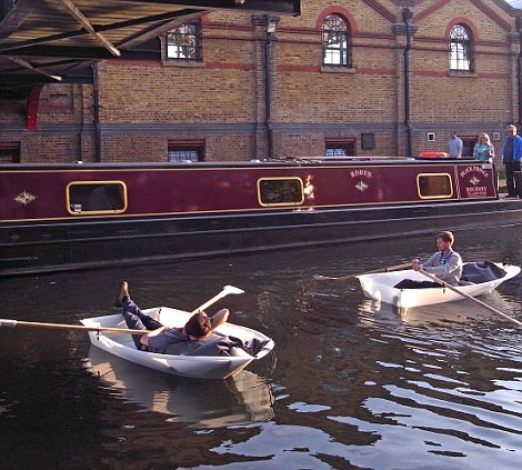 Foldboats in action: Their designers envisage the tiny rowing boats being used by boat hire companies