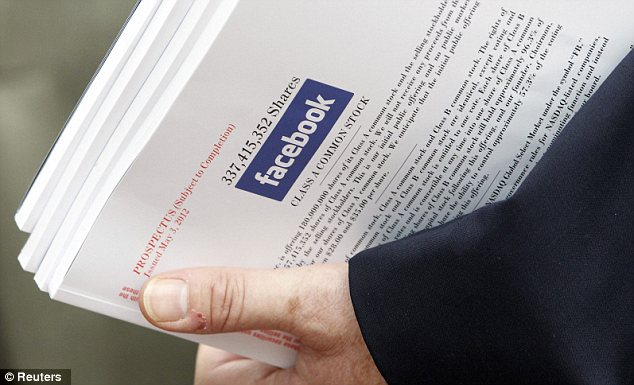 Good investment? An investor holds prospectus explaining the Facebook stock after attending a show for Facebook initial public offering in Boston, Massachusetts