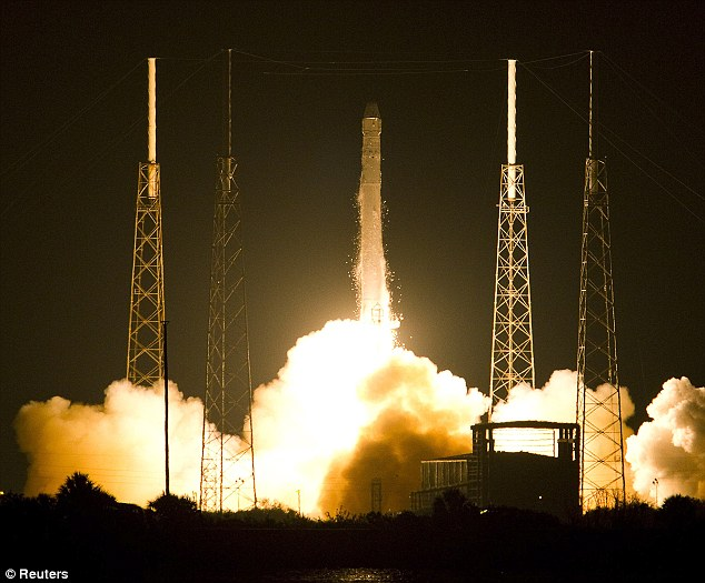 Up, up and away! Sparks fly as the rocket leaves the launch pad and heads to the horizons