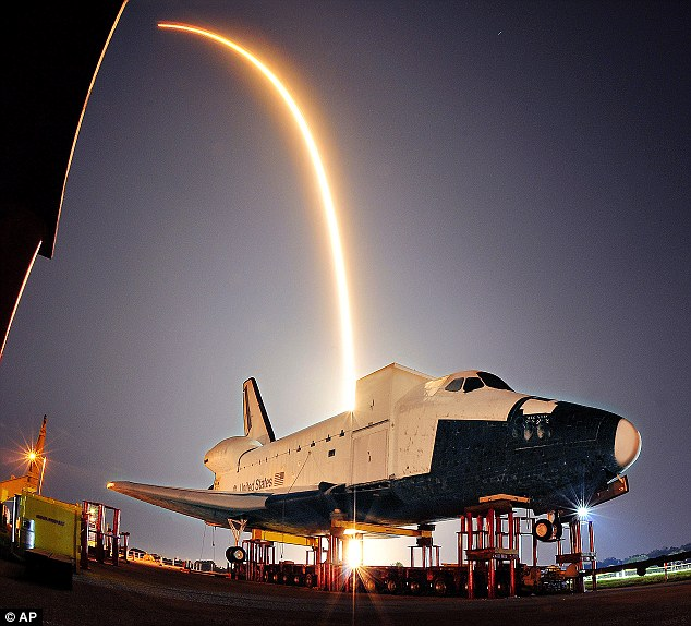 Another timelapse photograph show the rocket's trip into space, as another shuttle sits outside the Cape Canaveral site