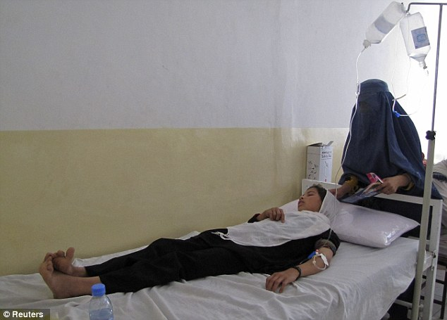 Poisoned: One of the girls receives treatment at a hospital after her school was targeted by the Taliban