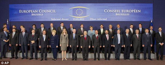Line-up: EU Heads of State pose for a group photo during the EU summit in Brussels last night