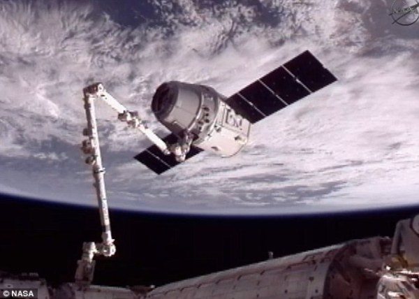 SpaceX Falcon 9 rocket Dragon capsule docks with