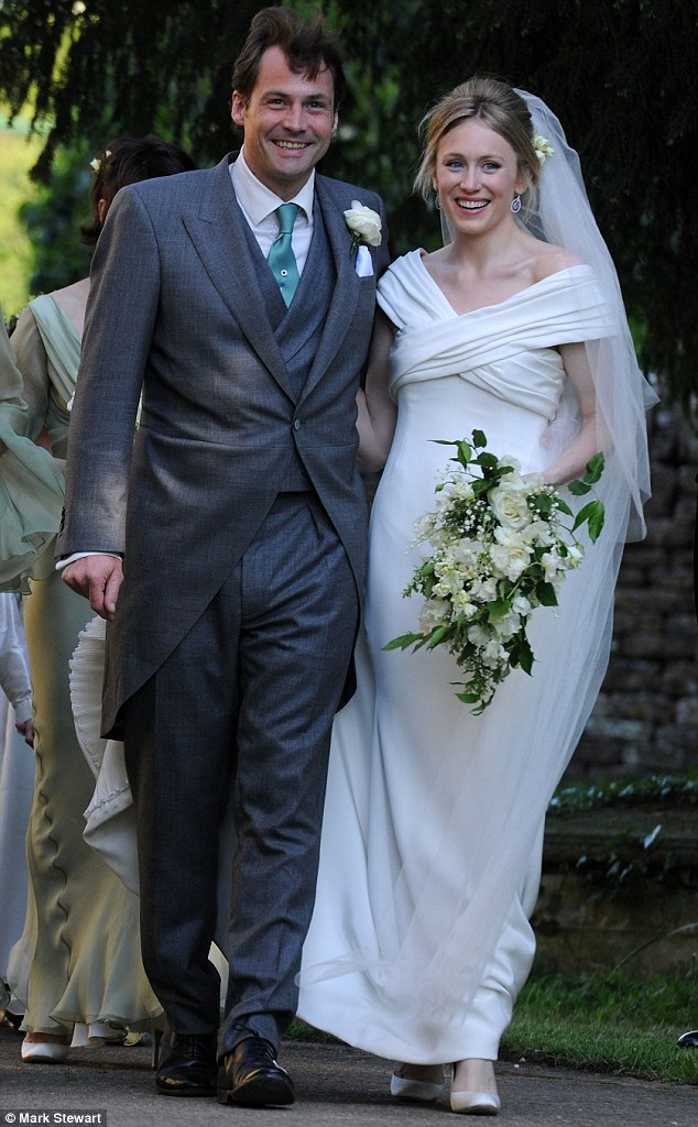 Big day: Bride Naomi Gummer, 27, with her husband Henry Allsopp, who married in Chadlington, Oxfordshire this weekend