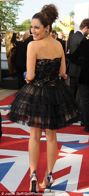 Black swan: Kelly Brook stuns at the 2012 Bafta Television Awards at the Royal Festival Hall in London