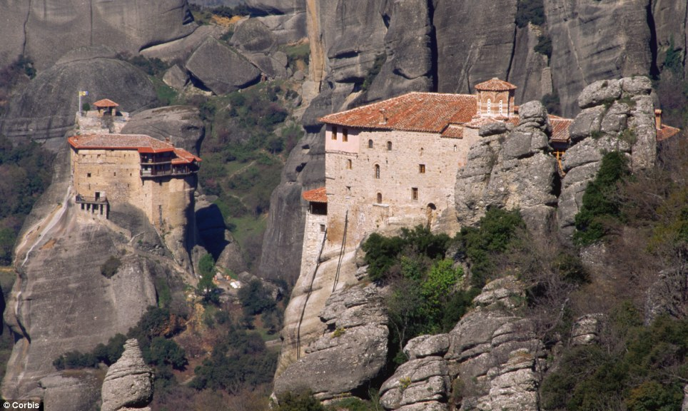 Don't look down! The monasteries of Agios Nikolaos Anapafsas (left) and Agia Roussanou (right) in Greece, which form part of the Meteora complex of precariously placed buildings