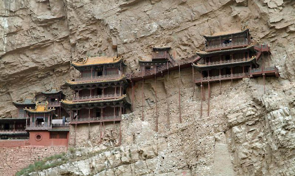 Gripping: This gravity-defying hanging monastery clings to the side of Mt Huashan in China and is only accessible via steep and dangerous paths