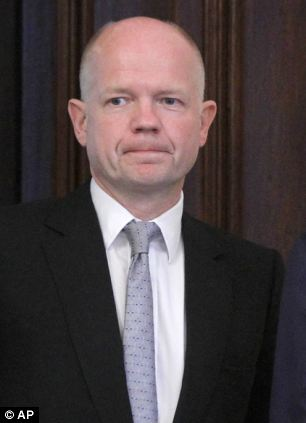 Foreign secretary William Hague, pictured meeting his Russian counterpart Sergey Lavrov in Moscow, is expected to officially announce the expulsion of three Syrian diplomats from the UK
