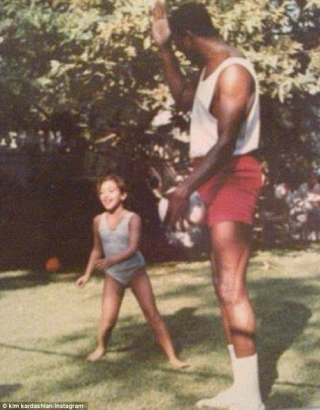 Flashback: The reality star also shared an old snap of her as a child with basket ball legend Magic Johnson