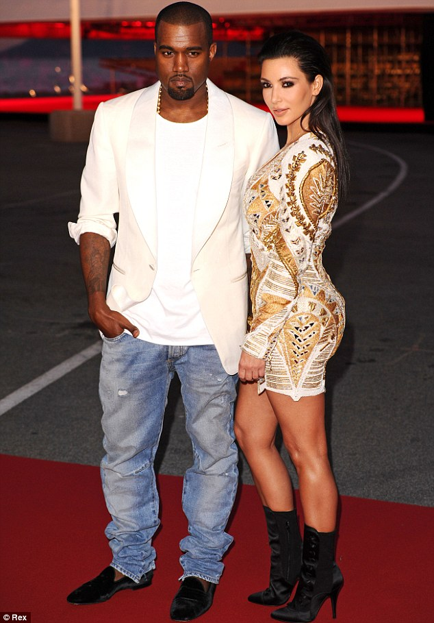 Moving fast: Kim and boyfriend Kanye West are apparently planning to move in together in Los Angeles