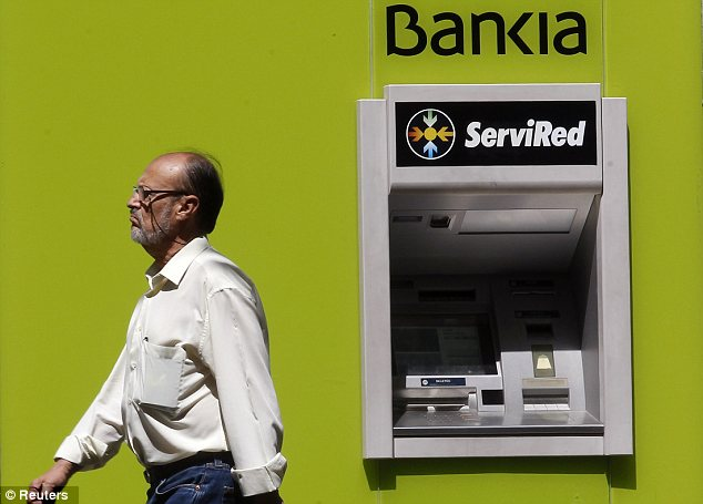 Crisis: Spain's government nationalised major bank Bankia earlier this month, and now says it needs to inject $23.6billion in public money into the bank