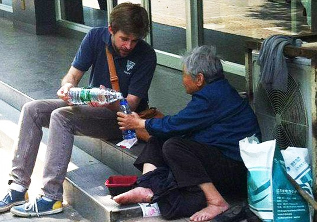 Image result for giving water to the homeless