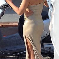 Mariah Carey hits bum note in unflattering gold dress