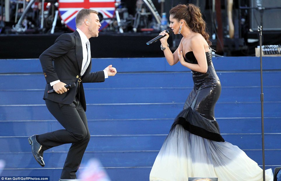 gary barlow from take taht and cheryl cole perform at the queen's diamond jubilee concert in front of the buckingham palace