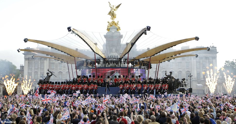 By royal appointment: The singers took to the elaborate stage with Buckingham providing a spectacular backdrop