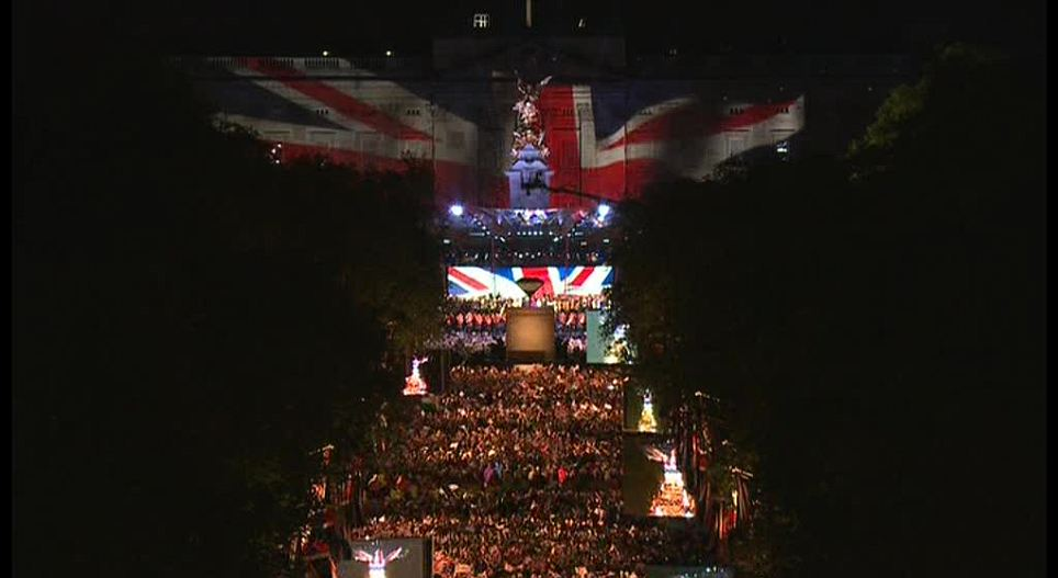 Flag flies above the Mall: Thousands watch the Union Flag raised after the concert finished