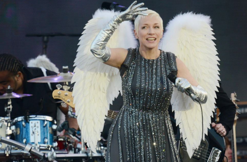 Like an angel: Annie Lennox had dressed in a glittering silver gown and angel wings
