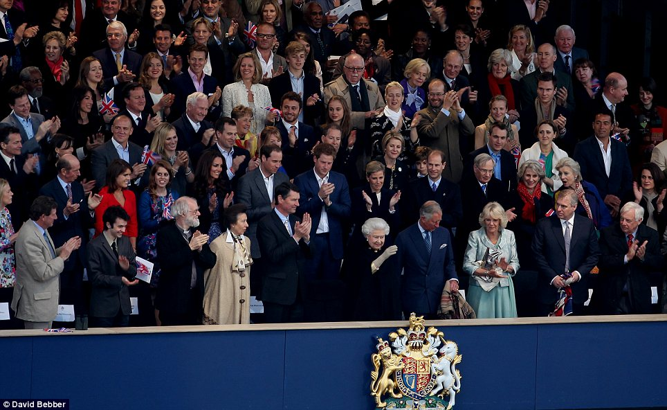 Welcomed: The Queen takes her seat as she arrives in the royal box during the spectacular concert