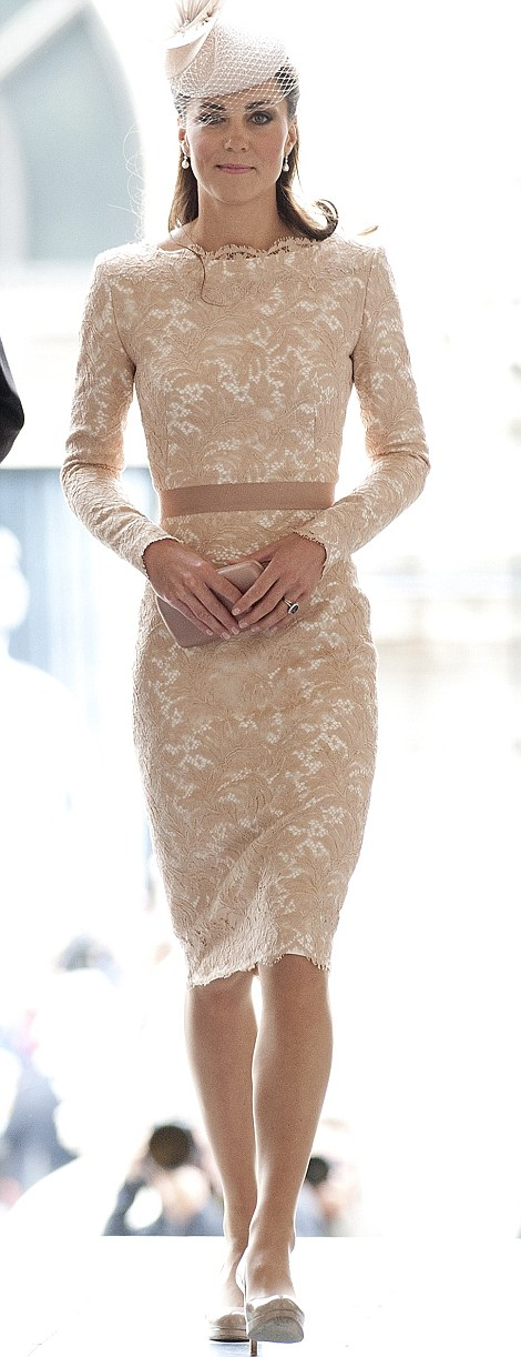 Royal blush: Kate shone in the slim-fitting dress, her slender waist accentuated by the ribbon belt