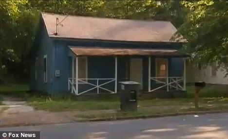 Crime scene: Elizabeth Hutcheson was found stabbed and bleeding in the porch of this house in Cedartown, Georgia where she had gone to deliver pizza