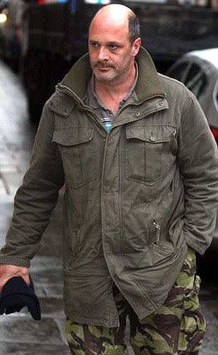 Andrew Summerfield (pictured at an earlier hearing) mutilated his own dog with a meat cleaver and repeatedly shot it with an air rifle