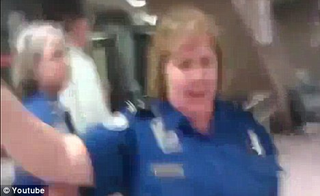 Denied: The TSA agents chase away her son, but he is able to film the heart-wrenching scene from afar