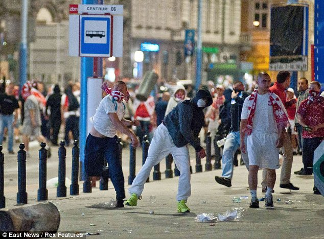 Aggravation: Polish and Russia fans kick off against each other after the match in Warsaw last night
