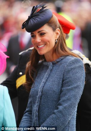 Adored: The Duchess smiled as she greeted the excited public and was handed posies