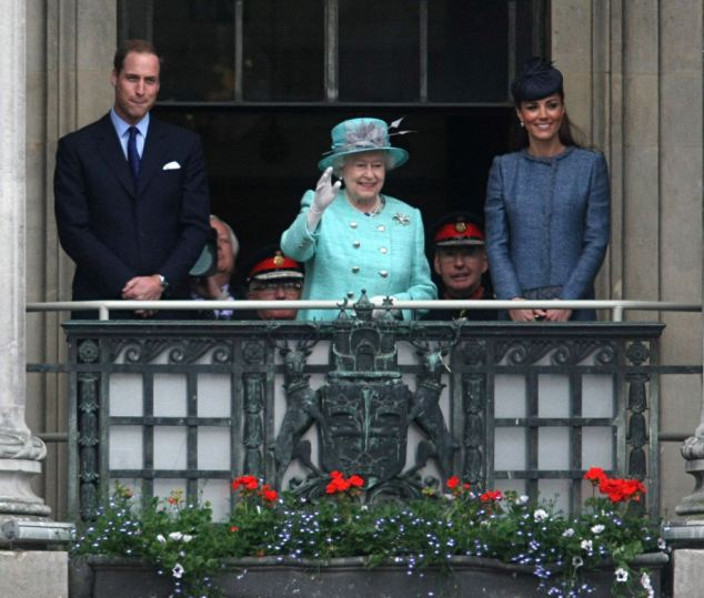 Shades of blue: After meeting the masses, William, Kate and the Queen headed into the Council House for a ballroom reception