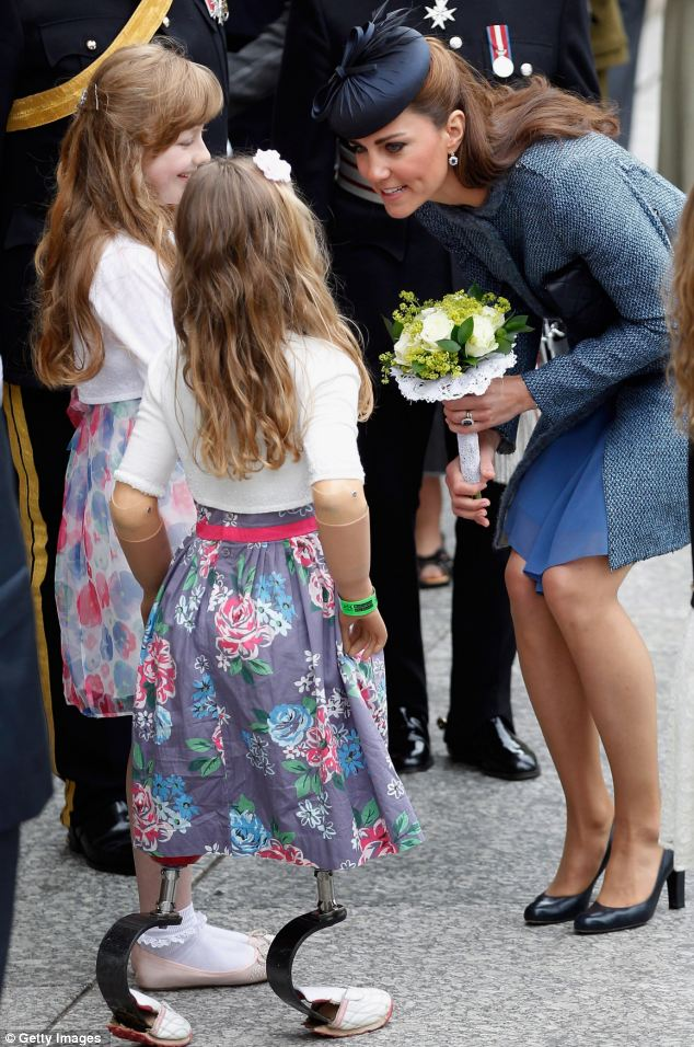 Kate's girls: The Duchess accepts a posy from eight-year-old Isabelle Weall (centre) outside Nottingham Town Hall